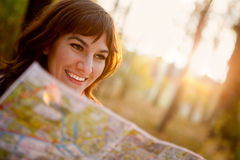 Female with a map Stock Photos