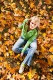 Female on maple leaves Stock Photos