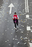 Female marathon runner lagging behind in Rott Stock Photography