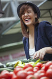 Female At Market Place. Young Female Buying Some Vegetables At Market Place Royalty Free Stock Photography