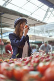 Female At Market Place. Young Female Buying Some Vegetables At Market Place Stock Photography