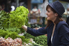 Female At Market Place. Young Female Buying Some Vegetables At Market Place Royalty Free Stock Photo