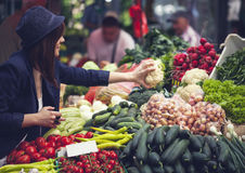 Female At Market Place. Young Female Choosing Vegetables At Market Place Royalty Free Stock Photography