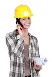 Female mason with plans Royalty Free Stock Photo