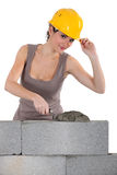 Female mason. Stock Photography