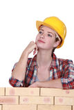 Female mason stood by wall Royalty Free Stock Photos