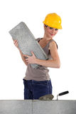 Female mason working Stock Photo