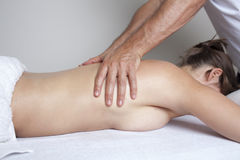 Female massage Stock Photos