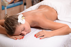 Female on massage table. Female laying down on massage table in spa Royalty Free Stock Image