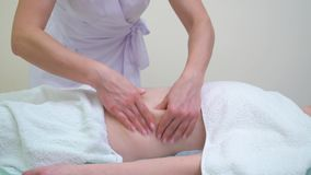Female masseur doing anti cellulite massage on abdomen of young woman. Professional body contouring treatment in beauty salon. people, beauty and spa treatment stock video footage