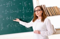 The female math teacher in the classroom. Female math teacher in the classroom royalty free stock image