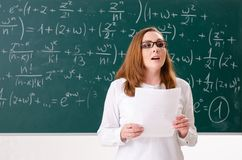 The female math teacher in the classroom. Female math teacher in the classroom royalty free stock photography