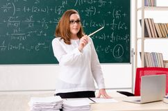 The female math teacher in the classroom. Female math teacher in the classroom royalty free stock images