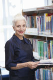 Female Mature Student Studying In Library Royalty Free Stock Photography