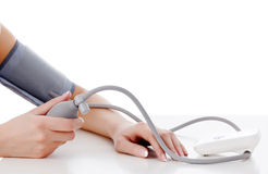 Female measures her blood pressure Stock Photography