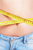Female measuring her waist Stock Image