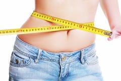Female measuring her waist Royalty Free Stock Photo