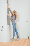 Female measuring with measure tape Royalty Free Stock Image