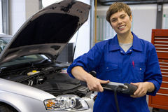 Female mechanic with electronic diagnostics device, portrait Royalty Free Stock Images