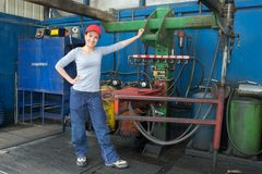 Female mechanic in factory royalty free stock images