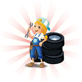 A female mechanic in front of the tires Stock Photo