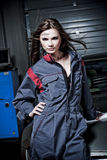 Female mechanic in garage. A young and beautiful female mechanic in the garage Royalty Free Stock Photos