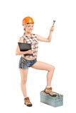 Female mechanic holding a wrench Stock Image