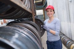Female mechanic looking for axle. Female mechanic looking for an axle Royalty Free Stock Photography