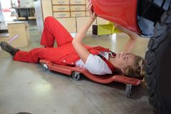 Female mechanic looking at car royalty free stock photos
