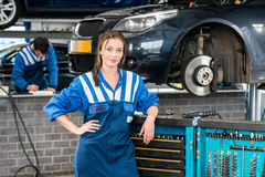 Female Mechanic Standing By Tool Trolley In Garage Royalty Free Stock Photos