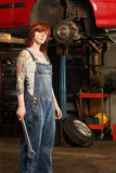 Female mechanic with tattoos Royalty Free Stock Photo