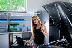 Female mechanic at work. auto service station. Royalty Free Stock Images