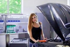 Female mechanic at work. auto service station. Stock Photos