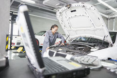 Female Mechanic working in Auto Repair Shop Stock Image