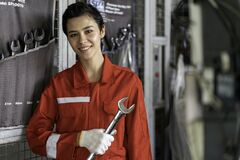 Free Female Mechanic Working In The Garage Stock Images - 208325264