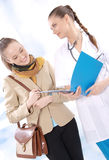 Female medical doctor and her patient Stock Photos