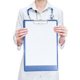 Female medical doctor holding  clipboard Royalty Free Stock Photos