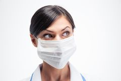 Female medical doctor in mask looking away Royalty Free Stock Photography