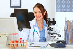 Female medical doctor sitting with roentgen Royalty Free Stock Photos