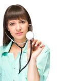 Female medical doctor with stethoscope isolated Royalty Free Stock Images