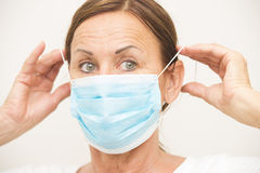 Female medical nurse with mask over face Royalty Free Stock Photo