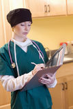 Female medical professional. Wearing surgical gear with medical chart Stock Photography