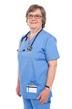 Female medical professional with stethoscope. Aged female medical professional  posing with stethoscope around her neck looking at camera Royalty Free Stock Images
