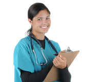 Female medical professional writing on clip board Royalty Free Stock Image