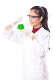 Female medical or scientific researcher holding at a liquid solution Royalty Free Stock Images