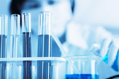 Female medical or scientific researcher using test tube on labor Stock Images