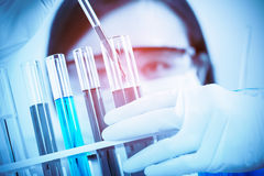 Female medical or scientific researcher using test tube on labor. Atory Royalty Free Stock Photos