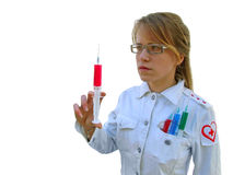 Female Medical Soldier. Female with a serious expression holds a large syringe royalty free stock photo