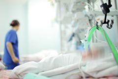 Female medical worker on the baby`s bedside in the NICU, unfocus Stock Photography
