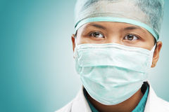 Female medical worker looking away Stock Photo